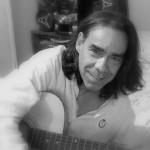 Danny Ruiz playing the guitar