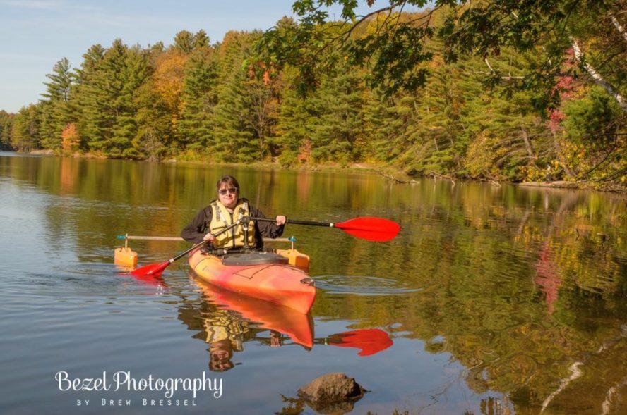 Jamie is in her kayak
